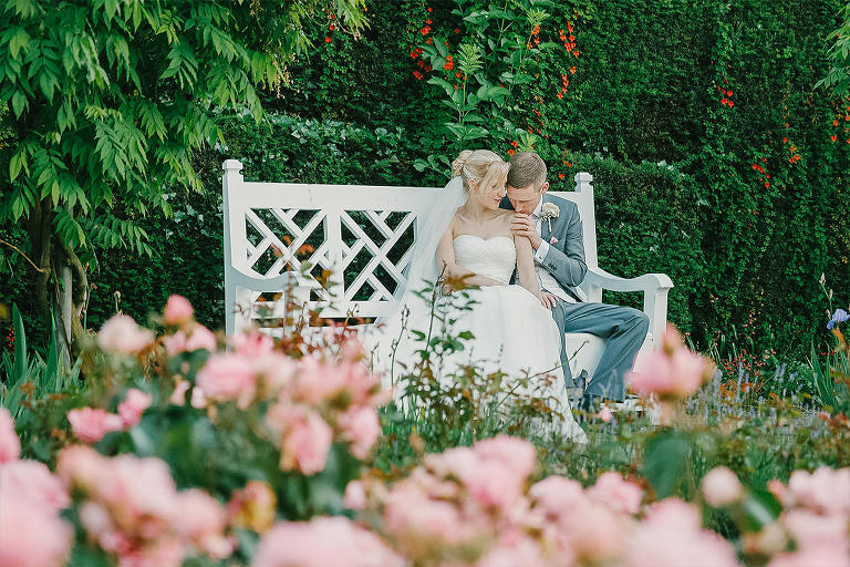 Romantic moments for the newly weds sitting in the gardens of Arley Hall