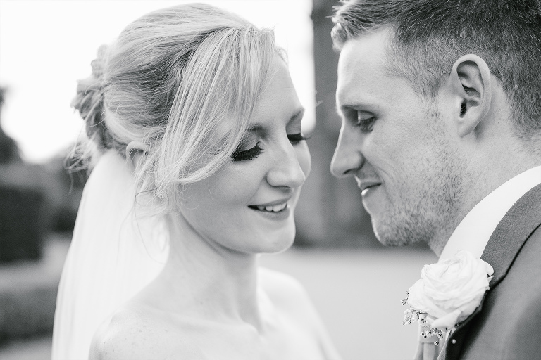 black and white photograph of bride and groom at Arley Hall, the look of love