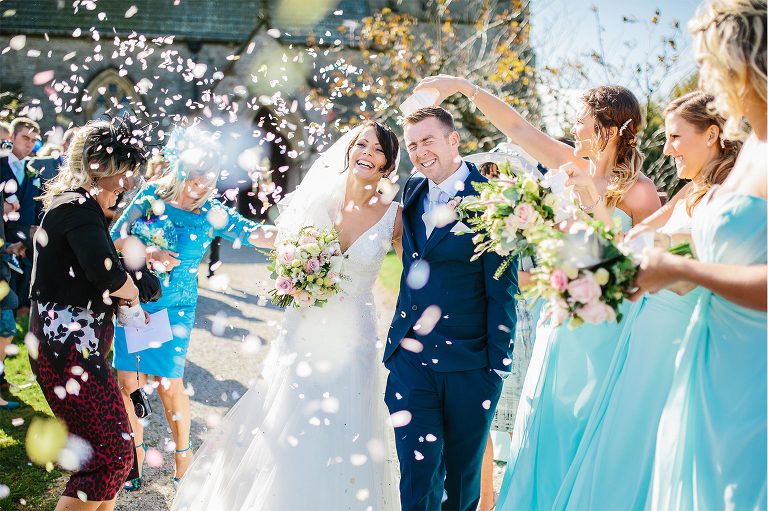Samantha Broadley Photography, Bride and Groom with lots of confetti very happy faces