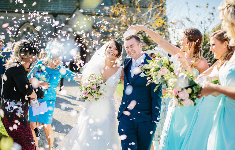 Sunny wedding Day, Happy faces with lots of Confetti for this Lancashire wedding couple