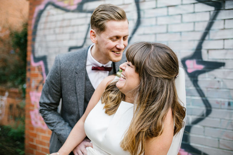 Big smiles and laughs from bride and groom at Victoria warehouse manchester wedding